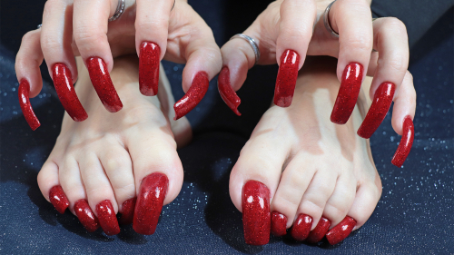 Long red glitter nails and toenails